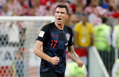 Why isn't Mario Mandzukic enjoying for Croatia in opposition to England at this time?